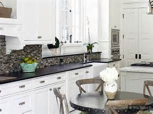 white counter tops white cabinets with subway tile