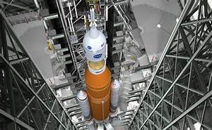 NASA Studies Whether to Add Crew to 1st SLS Megarocket ...