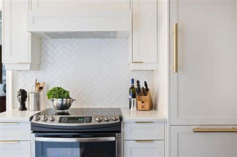 All White Kitchen with Herringbone Backsplash