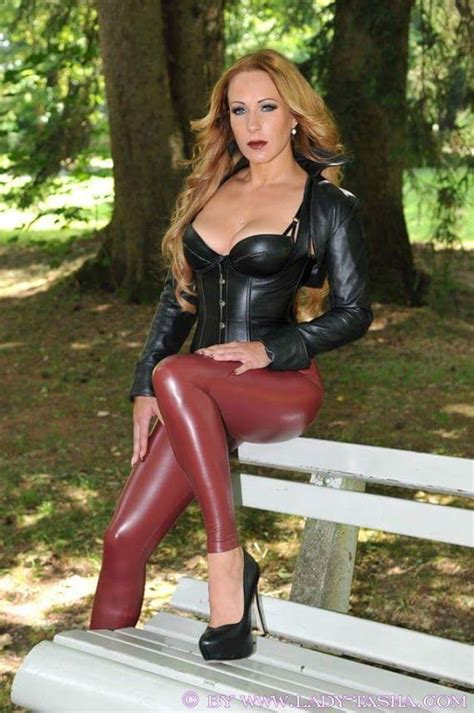Beautiful Blonde Lady In A Red Leather Leggings Red