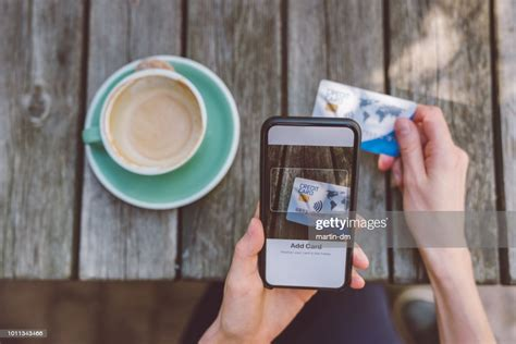 We did not find results for: Woman Adding Credit Card Into Digital Wallet High-Res Stock Photo - Getty Images