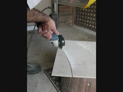 cutting porcelain tile cutting a freehand curve in a glazed tile