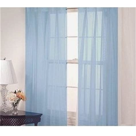 2 solid light blue sheer curtains fully