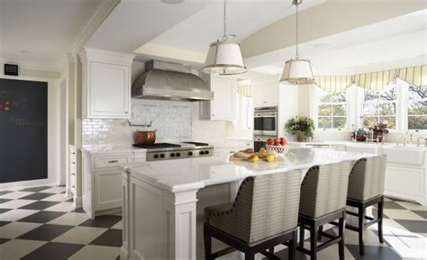 white kitchen with marble features and island counter
