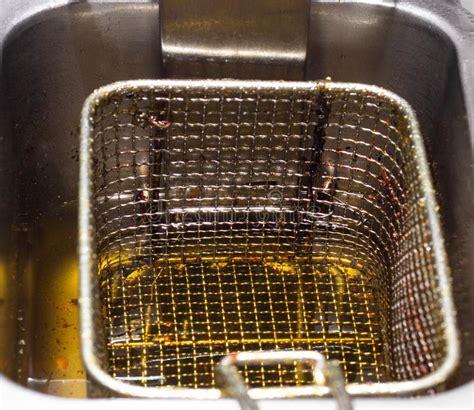 fryer deep oil kitchen restaurant harm junk cholesterol boiling close