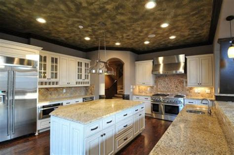 high end white kitchen cabinets soft white cabinets with a taupe glaze make this high end 7039