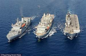 HMS Illustrious undergoes refuelling at sea alongside two ...