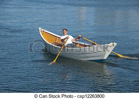 Dory Rowboat by Stock Photography Of Rowing A Dory Boat Rowing A