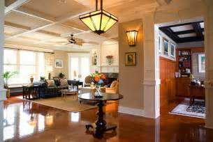 craftsman style home interiors warm lighting in a craftsman style entryway and family room