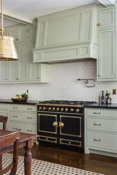 beautiful kitchen boasts light gray green cabinets paired
