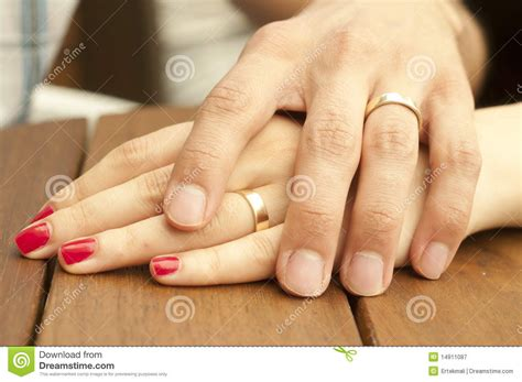 Young Married Couple Holding Hands Closeup Royalty Free