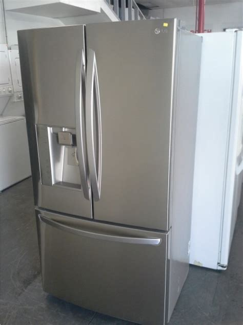used washers and dryers lg stainless steel door counter depth fridge out