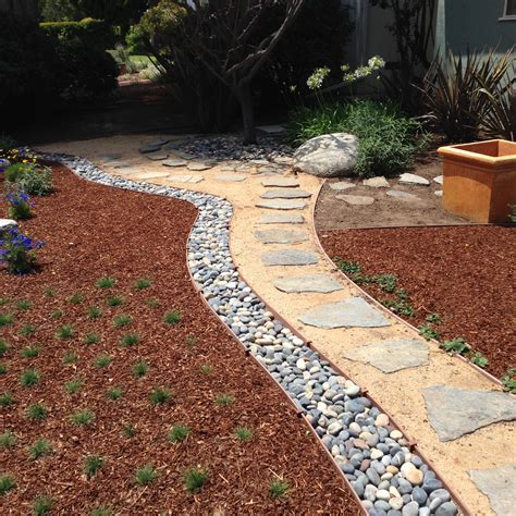 rocks for driveway start xeriscaping with a backyard rock garden bourget bros