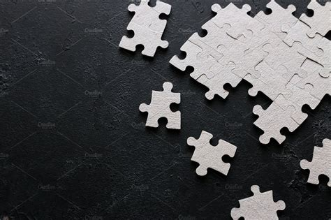 puzzle pieces  black background high quality business