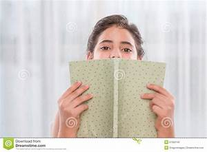 Hiding Behind A Book Stock Photo - Image: 57350140