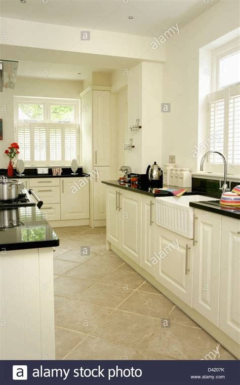 limestone flooring for kitchens limestone tiled floor in modern white kitchen with black 7114