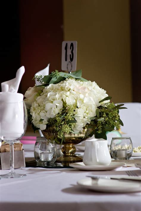 white hydrangea  seeded eucalyptus centerpiece