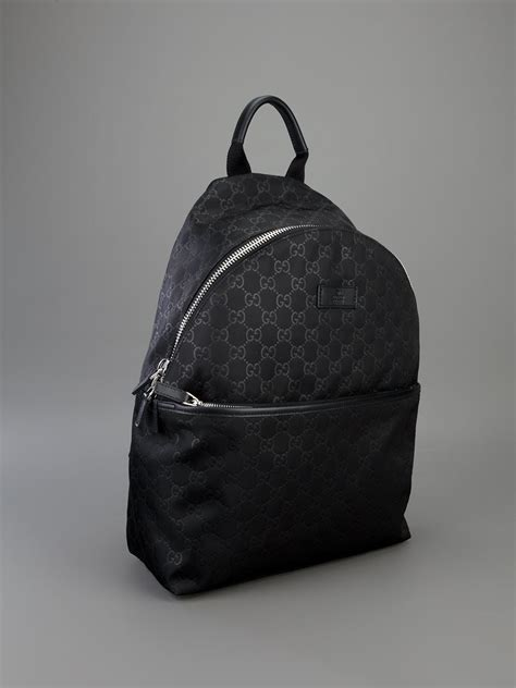 gucci embossed monogram backpack  black lyst