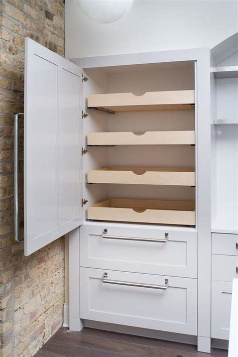 pantry with stacked pull out shelves transitional