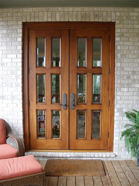 country brown wooden patio door and exposed brick