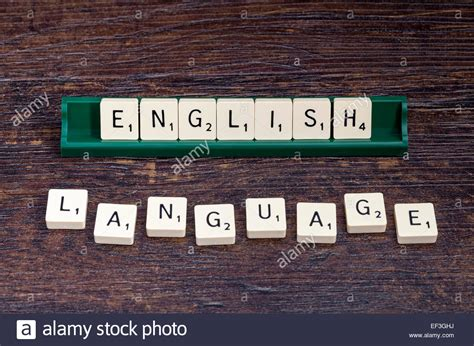 english language spelled out with scrabble letters stock