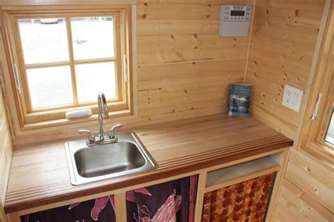 high school students build solar  grid tiny house