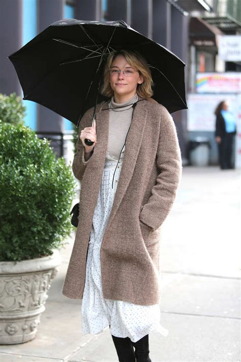 haley bennett carries an umbrella while out on the lower ...