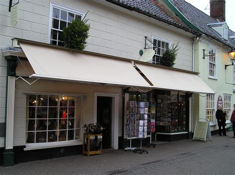 awnings including shop front folding arm  conservatory roof awnings