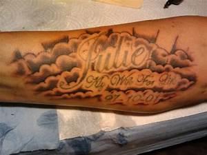 Tribute cloud arm tattoo - TattooMagz