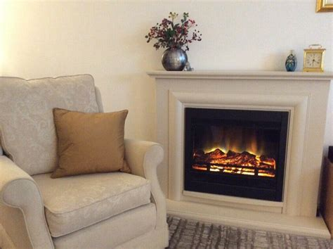 free standing fireplace with set in electric in