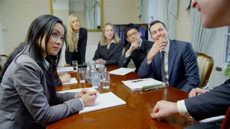 diverse business meeting attractive and diverse business team in a meeting around a