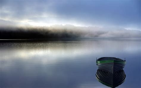 boats   calm lake surface  sunset wallpaper