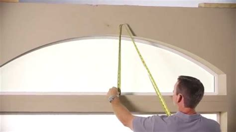 measuring   framed sunburst elongated arch  drywall