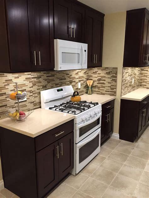 espresso kitchen cabinets  white appliances
