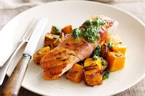 fish cuisine salmon wrapped in prosciutto with pesto and roast pumpkin recipes delicious com au