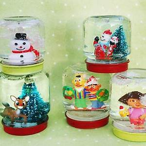 DIY mimi snow globes made from recycled baby food jars
