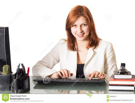 Smiling Girl Typing On A Computer Keyboard In The Office