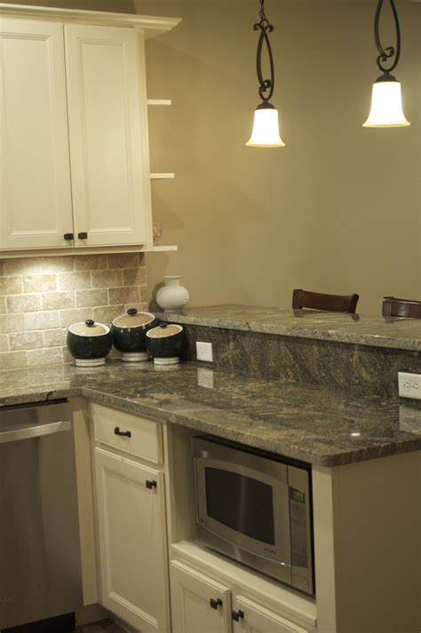 granite colors with white cabinets cmh builders antique white cabinets with built in