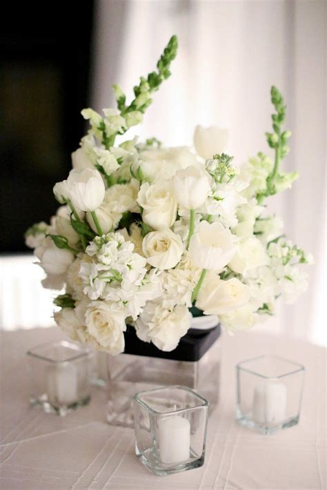 white centerpieces  tulips roses carnations
