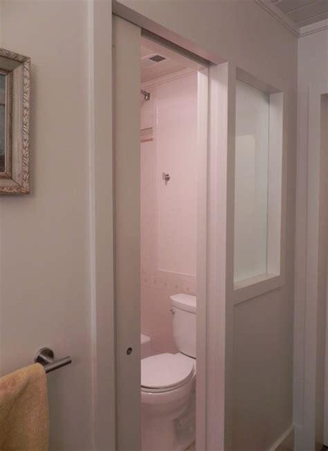 Pocket Door, Frosted Window Separating Toilet In Narrow