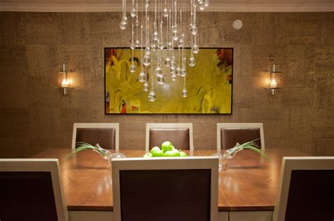 contemporary dining room with droplet chandelier
