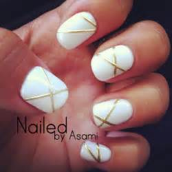 White and gold lines design with gel nails nail art