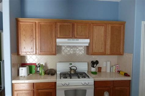 kitchen cabinets with blue walls cabinets wood and light blue walls kitchen with 9510