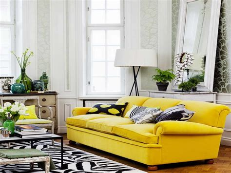 Grey Sofa With Cushions Also Yellow Wall Paint Decoration