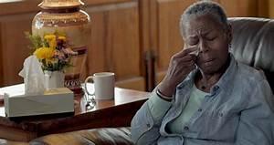 sad lonely elderly black wiping