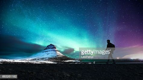 Northern Lights In Mount Kirkjufell Iceland With A Man
