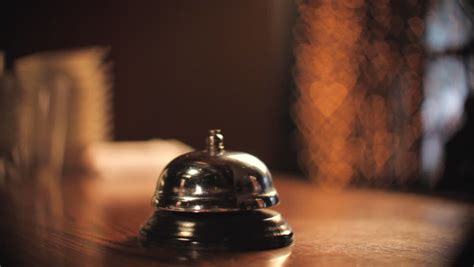 man ringing hotel reception bell male hand pushing