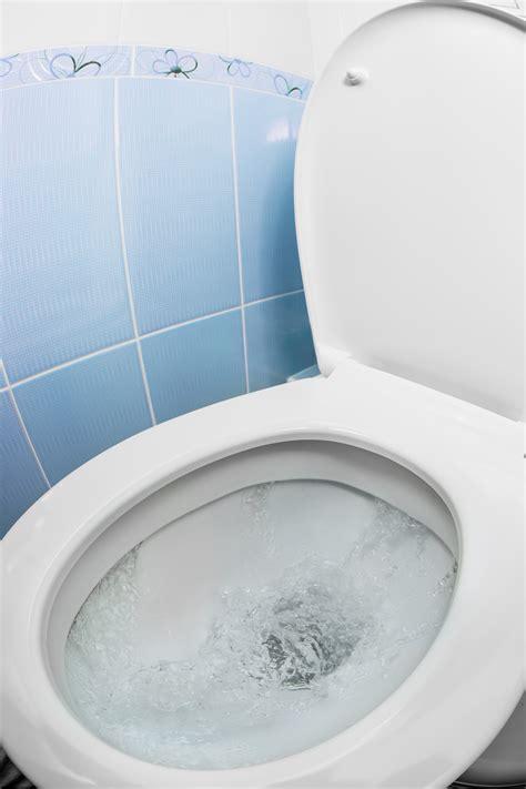 the flushing toilet water bathroom sre property managementsre property management