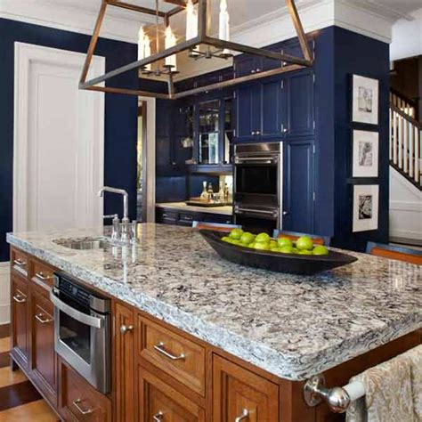 navy blue cabinet and opulent quartz countertop using