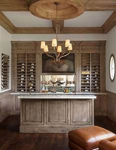 Amazing built in bar boast distressed cabinets under a ...